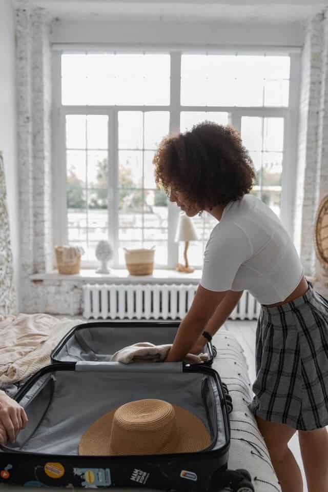 Woman packing clothes before leaving